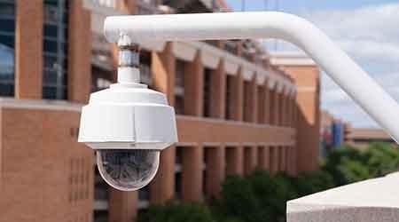 Video security camera housing on school