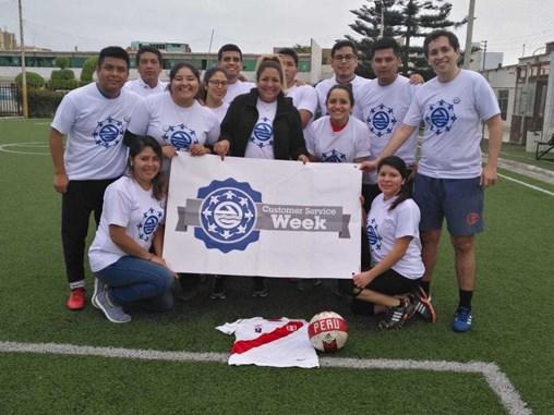 Peru soccer team presents bdp customer service week banner on field