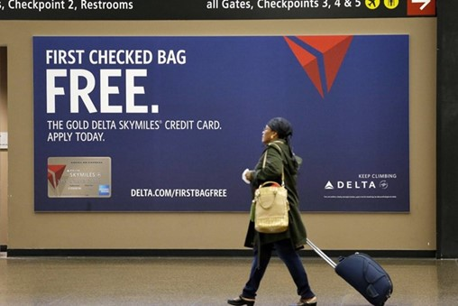 Delta Finds Revenue in Credit Cards and Upgrades